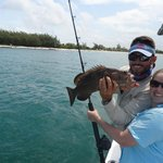 Capt Pepe and Tamara with Grouper