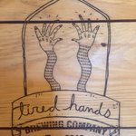 Tired hands logo print on wood.