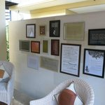 The wall of the dining area of the Writer's Suite is decorated with examples of beautiful writin