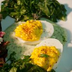 Devilled eggs with green tahini and garden spinach
