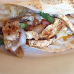 Chicken quesadilla a la carte with fajita chicken, grilled green peppers and onions, and cheese.