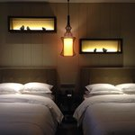 Double beds and pretty lighted shelves