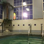 Super 8 sign through window of pool area