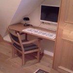desk nook with modern tv in single room