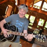 playing a guitar owned & signed my the Eagle's