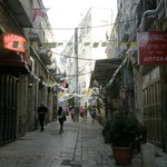 A view of the narrow street the hotel is in-Gloria on right past  flags