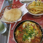 My lunch here: shakshuka, mint lemonade, pita bread, and french fries