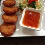 Sweetcorn cakes with sweet chilli sauce.