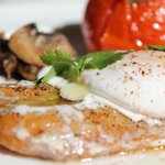 Smoked fish topped with poached egg