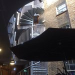 Courtyard Area with spiral staircase to upper floors where the hotel rooms are (there is a lift