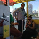 Tourists and local residents use the False Creek Ferry
