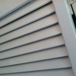 Unit 94 - dusty louvres on laundry room doors