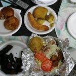 A little bit of everything good. Fried pork. Mofongo. Salad.  Sweet potato, fried ripe plantain.