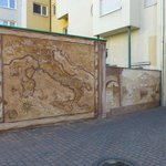 Mural map of Italy in secured parking behind hotel