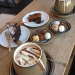 Selection of chocs. Salted caramel brownie, chocolate cake, hot choc and a mocha.