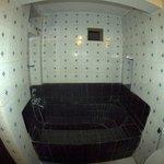 Bathroom with black bathtub