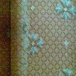 Threadbare carpet on main staircase