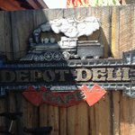 Fun old sign welcoming diners in the garden