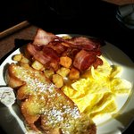 French toast, bacon, eggs and hash browns