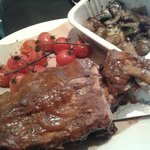 Rack of ribs, smoked tomatoes and mushrooms