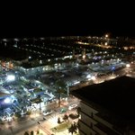 View from the poolside at night over marina.