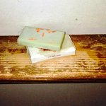 Soap on badly-worn wooden shelf