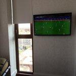 Wall-mounted TV, window facing south toward Fulton Street