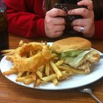 Grilled chicken sandwich with fries and yummy onion ring