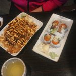 Sushi with tempura crumbs and special sauce; dragon roll