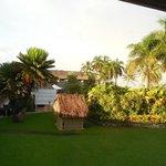 Rays of dawn on hotel garden