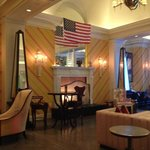 Lobby w fireplace antiques/modern mix high ceilings. clean!