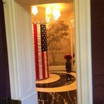 view from center entry way dog with 4thjuly hat and flag