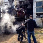 PBS crew shooting steam engine as it is prepped for run