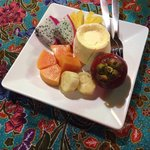 Beautiful vanilla ice cream with exotic fruit. Perfect for after a spicy dish!