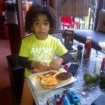 My son Jabez enjoying his burger @ Mojito