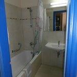 lovely tiled bathroom with full bath