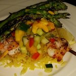 Jumbo shrimp skewer special with fresh summer mango salsa and grilled asparagus