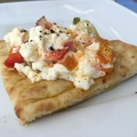 Baked feta with peppers on fresh pita!