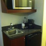 A sink, microwave and personal fridge