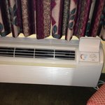 Air conditioner fan a little noisy, a constant background hum, but it's about normal for this ty
