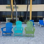 Chairs on sand right outside beachfront room.
