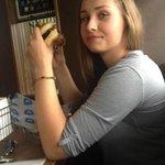 enjoying the burger at Delux