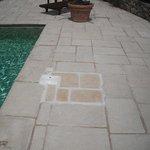 Tiling poor, slabs loose and mortar missing