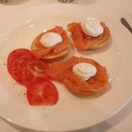 Toasted bagels, smoked salmon, cream cheese and tomatoes.