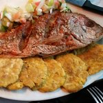 Fresh fried red snapper with fried plantains.