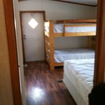 Deluxe Two-Room Cabin Interior (Bedroom with Queen and Twin Bunks)