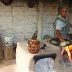 Local lady in village making fresh snack