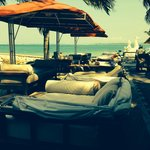Comfortable, cushioned lounging spaces on the beach