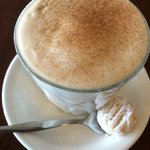 Chai latte with complementary biscuit