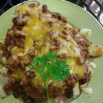 Chili cheese fries (chili has beans in it, and comes with grilled onions). The chili is good.